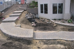Rustic AB Stone block retainer wall steps with custom inset rock