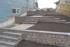 Rustic Pisa 2 with Charcoal capstone tiered block retainer wall with steps