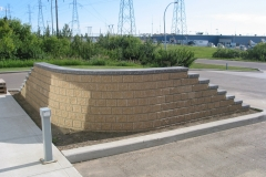 Dessert Buff with Charcoal capstone block retainer wall