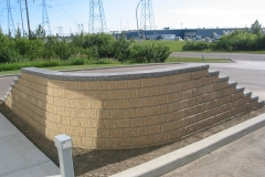 Dessert Buff Pisa 2 with Charcoal capstone block retainer wall