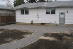Rustic Cobble paving stone patio and sidewalk with charcoal border