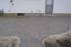 Rustic Cobble paving stone patio with charcoal border and inset sidewalk