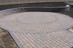 Rustic Cobble paving stone patio with charcoal border