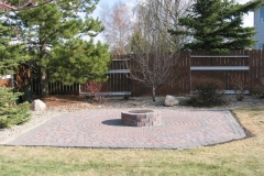 Northern Cobble paving stone patio with charcoal border and fire pit