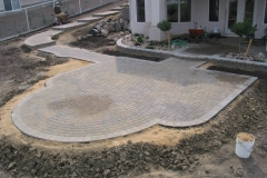 Rustic Cobble paving stone patio with grey Roman Euro border