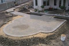 Rustic Cobble paving stone patio with grey Roman Euro border