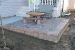 Rustic Holland raised paving stone patio