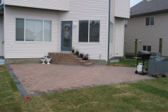 Dessert buff Holland paving stone patio with charcoal border