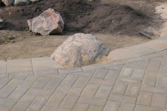 Rustic Holland paving stone sidewalk with rock custom cut in