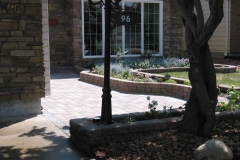 Northern Roman Euro paving stone sidewalk with garden wall