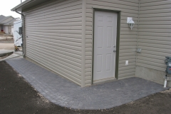 Charcoal Cobble paving stone sidewalk with half circle at door